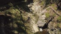 Fly above a creek with drone in 4K