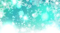 beautiful snowflakes rotating on a blue background lens flare bokeh