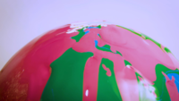 Pink And Green Paint On Glass Sphere