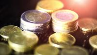 Euro coin on wooden table- financial power concept, closeup dolly shot