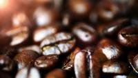 Coffee beans close up with warm bokeh light in the background