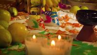 Sugar Skulls And Candles In Mexican Offering