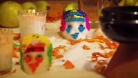 Sugar Skulls And Cempasuchil Petals In Mexican Offering