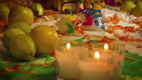 Sugar Skulls In Mexican Offering With Candles In Foreground