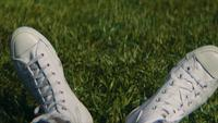 Close Up Of White Sneakers On The Grass