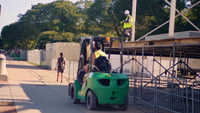 Green Lift Trucks Moving In Grant Park