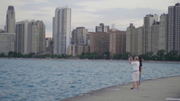 Couple Taking Pictures Of The Chicago City From A Dock