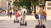 People On Segways Crossing The Street In Chicago