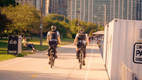 Couple Of Police Officers On Bike Lane Moving Away