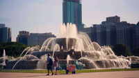 People Taking Pictures Next To The Buckingham Memorial Fountain