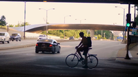 Cyclist In A Tunnel Waiting To Cross The Street