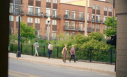 People Walking On Sidewalk Near The Park