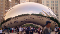Long Shot Of The Bean Reflecting People And buildings
