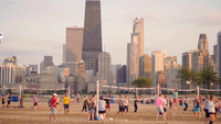 Volleybollsdomstolar i North Avenue Beach och byggnader i Chicago
