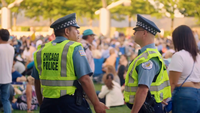 Chicago Police Officers In Outdoor Auditorium In Millenium Park
