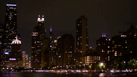 Night Shot Of Chicago City Skyline And Fast Car Lights Moving
