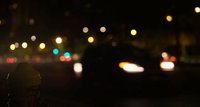 Night Shot Of Car Lights With Small Post In Foreground