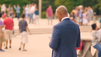 Man Checking His Phone In Millennium Park Chicago