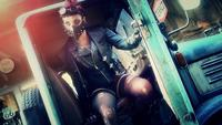 Tank girl sitting an posing in old rusty truck outllaw