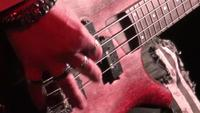 bass guitar in live action at a concert - rack focus - close up