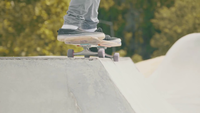 Medium Shot Of A Man Skating A Concrete Ramp