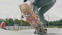 Man Skating And Approaching On Concrete Ramps