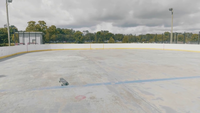 Traveling Shot Of An Outdoor Roller Rink On A Sunny Day