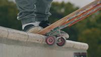 Close Up Of Skateboard Wheels And Man Feet Skating