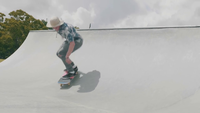 Young Man Skating On A Ramp And Falling In A Skate Park