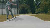 Young Man Skating On A Little Ramp In A Skate Park