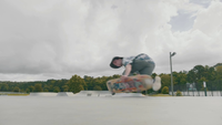 Man Skating On Concrete Ramps And Approaching