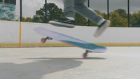 Close Up Of Man Making A Skate Trick And Keeping The Balance