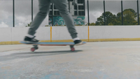 Close Up Of Skateboard Trick On Two Wheels