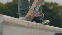 Close Up Of Skateboard Wheels And Man Feet