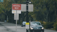 Wrong Way Sign In The Street Slow Motion