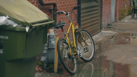 Handheld Clip Of Golden Bycicle in Alleys Of Georgia