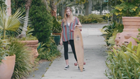 Young Woman Spinning Her Longboard And Dropping It