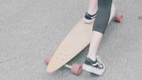 Medium Shot Of Young Woman Riding Her Longboard