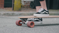 Close Up Of  Woman Feet Pushing Her Longboard