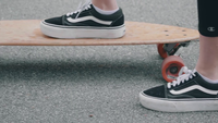 Close Up Of  Woman Feet Moving Her Longboard