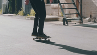 Bearded Man Riding His Skateboard Approaching In Alley