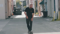Bearded Man Practicing Skateboard In The Alley