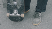 Close Up Of  Man Feet Moving A Skateboard