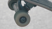 Extreme Close Up Of Skateboard Wheel Rolling