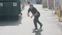 Bearded Man Skating In The Alley And Making A Jump