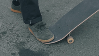 Close Up Of  Man Feet And Skateboard In The Street