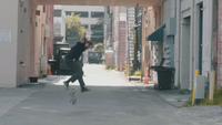 Man Practicing Skateboarding Tricks In The Alley