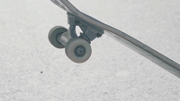 Close Up Of Man Rolling A Wheel Of His Skateboard