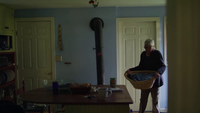 Handheld Clip Of Old Lady In Her House Holding A Laundry Basket