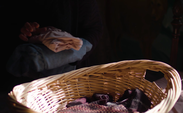 Close Up Of Old Lady Placing Her Laundry Basket On Her Bed